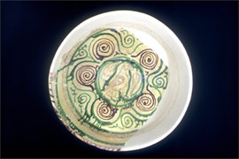 Glazed bowl with painted sgraffito decoration