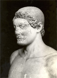 The upper part of kouros with the cropped hair and the short intricate locks