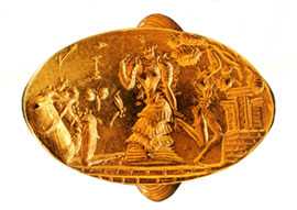 Golden ring with worship scene