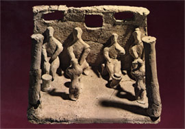 Clay model of a temple with worshippers