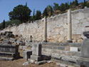 The stoa of the Athenians, in the background the polygonal wall