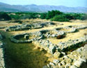 The eight circular structures used for the storage of grain (silos) at the SW corner of the of the Malia palatial complex